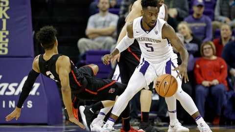 Washington's Jaylen Nowell (5) turns one way as Seattle's Jordan Hill (2) tumbles behind in the first half of an NCAA college basketball game Friday, Nov. 24, 2017, in Seattle. (AP Photo/Elaine Thompson)