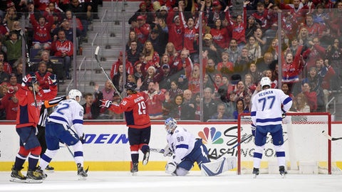 Washington Capitals left wing Alex Ovechkin, left, of Russia, celebrates his goal with Washington Capitals center Nicklas Backstrom (19), of Sweden, against Tampa Bay Lightning goalie Andrei Vasilevskiy (88), of Russia, defenseman Victor Hedman (77), of Sweden, and defenseman Andrej Sustr (62), of Czech Republic, during the first period of an NHL hockey game, Friday, Nov. 24, 2017, in Washington. (AP Photo/Nick Wass)