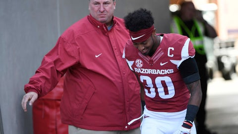 Arkansas coach Bret Bielema holds back tears as the senior Kevin Richardson III is introduced at the team's NCAA college football game against Missouri on Friday, Nov. 24, 2017, in Fayetteville, Ark. Bielema was fired following a 48-45 loss. (AP Photo/Michael Woods)