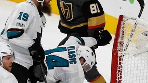 Vegas Golden Knights center Jonathan Marchessault (81) celebrates after scoring the game-winning goal against the San Jose Sharks during overtime of an NHL hockey game Friday, Nov. 24, 2017, in Las Vegas. Vegas won 5-4. (AP Photo/John Locher)
