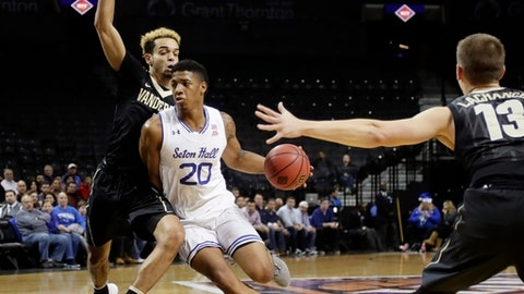Seton Hall's Desi Rodriguez (20) drives past Vanderbilt's Matthew Fisher-Davis (5) during the first half of an NCAA college basketball game in the consolation round of the NIT Season Tip-Off tournament Friday, Nov. 24, 2017, in New York. (AP Photo/Frank Franklin II)