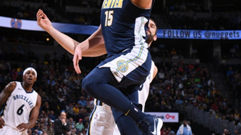 DENVER, CO - NOVEMBER 24: Nikola Jokic #15 of the Denver Nuggets goes for a lay up against the Memphis Grizzlies on November 24, 2017 at the Pepsi Center in Denver, Colorado. NOTE TO USER: User expressly acknowledges and agrees that, by downloading and/or using this photograph, user is consenting to the terms and conditions of the Getty Images License Agreement. Mandatory Copyright Notice: Copyright 2017 NBAE (Photo by Garrett Ellwood/NBAE via Getty Images)
