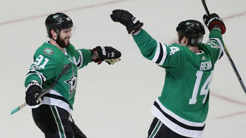 Dallas Stars center Tyler Seguin (91) celebrates his third goal of the night with Jamie Benn (14) during the third period of an NHL hockey game against the Calgary Flames in Dallas, Friday, Nov. 24, 2017. The Stars won 6-4. (AP Photo/LM Otero)