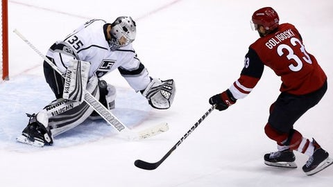 Los Angeles Kings goalie Darcy Kuemper (35) makes a save on a shot by Arizona Coyotes defenseman Alex Goligoski (33) during overtime of an NHL hockey game Friday, Nov. 24, 2017, in Glendale, Ariz. The Coyotes defeated the Kings 3-2. (AP Photo/Ross D. Franklin)