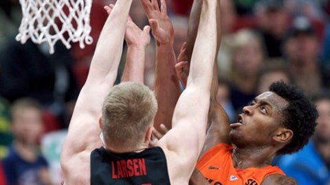 Florida forward Keith Stone, right, and Gonzaga center Jacob Larsen jump for a rebound during the first half of an NCAA college basketball game in the Phil Knight Invitational tournament in Portland, Ore., Friday, Nov. 24, 2017. (AP Photo/Craig Mitchelldyer)