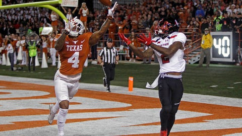 Texas defensive back DeShon Elliott (4) knocks the ball away from Texas Tech receiver Keke Soutee (2) during the second half of an NCAA college football game, Friday, Nov. 24, 2017, in Austin, Texas. Texas Tech won 27-23. (AP Photo/Michael Thomas)