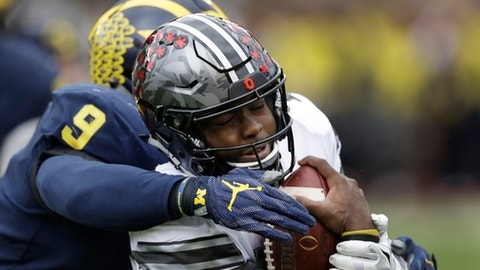 Ohio State quarterback J.T. Barrett (16) is sacked by Michigan linebacker Mike McCray (9) during the first half of an NCAA college football game, Saturday, Nov. 25, 2017, in Ann Arbor, Mich. (AP Photo/Carlos Osorio)