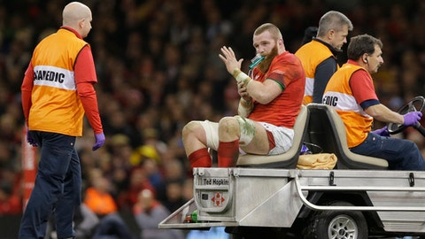 Wales's Jake Ball waves to the crowd as he taken off by the medial cart following an injury during the rugby union international between Wales and New Zealand in Cardiff, Wales, Saturday, Nov. 25, 2017. (AP Photo/Alastair Grant)