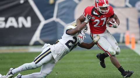 Georgia running back Nick Chubb (27) runs past Georgia Tech defensive back Lawrence Austin (20) during the second half of an NCAA college football game, Saturday, Nov. 25, 2017, in Atlanta. Georgia won 38-7. (AP Photo/John Bazemore)