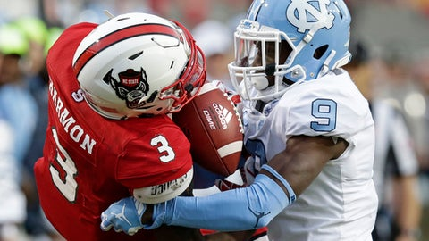 North Carolina cornerback K.J. Sails (9) defends as North Carolina State wide receiver Kelvin Harmon (3) catches a pass during the first half of an NCAA college football game in Raleigh, N.C., Saturday, Nov. 25, 2017. (AP Photo/Gerry Broome)