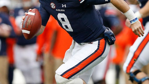 Auburn quarterback Jarrett Stidham runs the ball during the first half of the Iron Bowl NCAA college football game against Alabama, Saturday, Nov. 25, 2017, in Auburn, Ala. (AP Photo/Brynn Anderson)