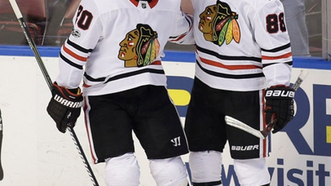 Chicago Blackhawks right wing Patrick Kane (88) celebrates his goal with teammate Brandon Saad (20) during the second period of an NHL hockey game against the Florida Panthers, Saturday, Nov. 25, 2017, in Sunrise, Fla. (AP Photo/Terry Renna)