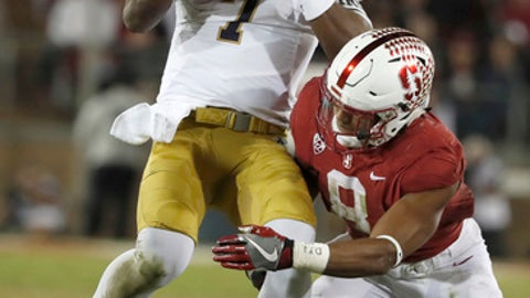 Notre Dame quarterback Brandon Wimbush (7) is tackled short of a first down by Stanford safety Justin Reid (8) during the first half of an NCAA college football game Saturday, Nov. 25, 2017, in Stanford, Calif. (AP Photo/Tony Avelar)