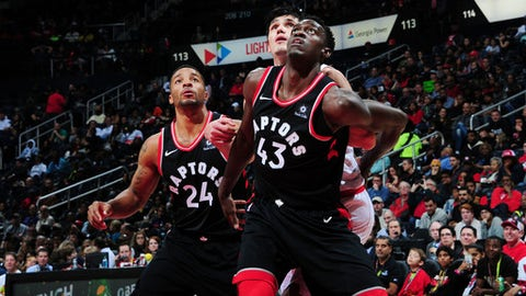 ATLANTA, GA - NOVEMBER 25: Pascal Siakam #43 and Norman Powell #24 of the Toronto Raptors box out Ersan Ilyasova #7 of the Atlanta Hawks on November 25, 2017 at Philips Arena in Atlanta, Georgia.  NOTE TO USER: User expressly acknowledges and agrees that, by downloading and/or using this Photograph, user is consenting to the terms and conditions of the Getty Images License Agreement. Mandatory Copyright Notice: Copyright 2017 NBAE (Photo by Scott Cunningham/NBAE via Getty Images)