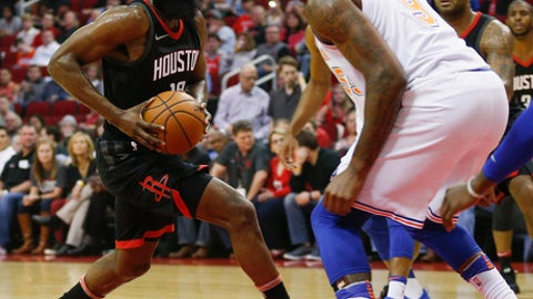 HOUSTON, TX - NOVEMBER 25:  James Harden #13 of the Houston Rockets drives towards the basket as Kyle O'Quinn #9 of the New York Knicks defends at Toyota Center on November 25, 2017 in Houston, Texas.  (Photo by Bob Levey/Getty Images)
