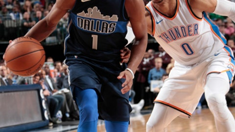 DALLAS, TX - NOVEMBER 25: Dennis Smith Jr. #1 of the Dallas Mavericks handles the ball against the Oklahoma City Thunder on November 25, 2017 at the American Airlines Center in Dallas, Texas. NOTE TO USER: User expressly acknowledges and agrees that, by downloading and or using this photograph, User is consenting to the terms and conditions of the Getty Images License Agreement. Mandatory Copyright Notice: Copyright 2017 NBAE (Photo by Glenn James/NBAE via Getty Images)