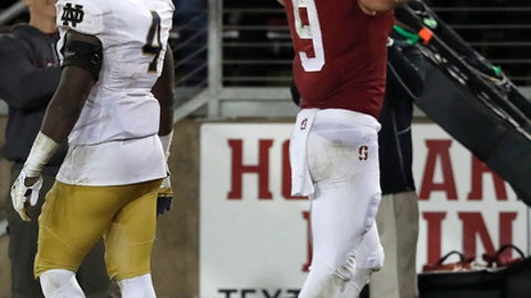 Stanford tight end Dalton Schultz (9) celebrates after catching a touchdown pass in front of Notre Dame linebacker Te'von Coney (4) during the second half of an NCAA college football game Saturday, Nov. 25, 2017, in Stanford, Calif. (AP Photo/Tony Avelar)