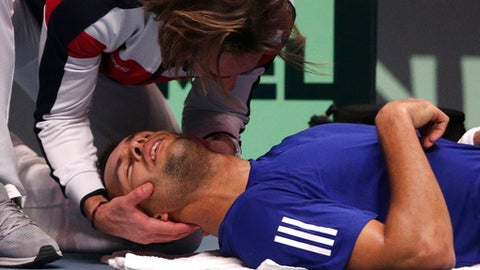 France's Jo-Wilfried Tsonga is being treated after losing the first set against Belgium's David Goffin during their Davis Cup final single match at the Pierre Mauroy stadium in Lille, northern France, Sunday, Nov. 26, 2017. (AP Photo/Michel Spingler)