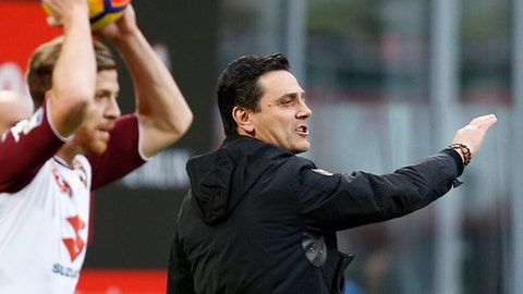 AC Milan coach Vincenzo Montella gives indications during the Serie A soccer match between AC Milan and Torino at the San Siro stadium in Milan, Italy, Sunday, Nov. 26, 2017. (AP Photo/Antonio Calanni)