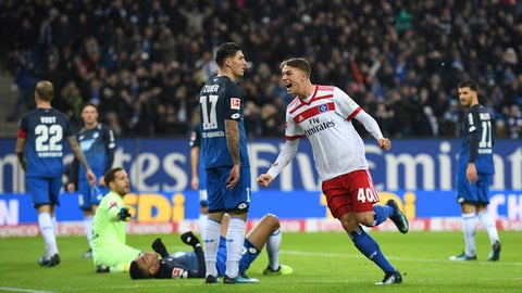 Hamburg's Jann-Fete Arp, right,  celebrates after an own goal by Hoffenheim's Kevin Akpoguma during the German Bundesliga soccer match between Hamburger SV and 1899 Hoffenheim in the Volksparkstadion in Hamburg, Germany, Sunday, Nov. 26,  2017. (Daniel Reinhardt/dpa via AP)