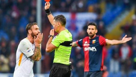 Referee Piero Giacomelli shows Roma's Daniele De Ross a red card, during the Serie A soccer match between Genoa and Roma, at the  Luigi Ferraris Stadium in Genoa, Italy, Sunday, Nov. 26, 2017. (Simone Arveda/ANSA via AP)