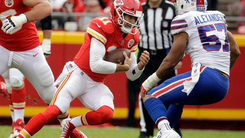 Kansas City Chiefs quarterback Alex Smith (11) braces for a tackle attempt by Buffalo Bills linebacker Lorenzo Alexander (57) during the first half of an NFL football game in Kansas City, Mo., Sunday, Nov. 26, 2017. (AP Photo/Charlie Riedel)