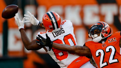 Cleveland Browns wide receiver Ricardo Louis (80) misses a pass with Cincinnati Bengals cornerback William Jackson (22) in pursuit in the second half of an NFL football game, Sunday, Nov. 26, 2017, in Cincinnati. (AP Photo/Gary Landers)