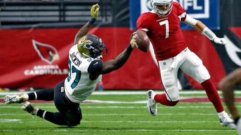 Arizona Cardinals quarterback Blaine Gabbert (7) is dragged down by Jacksonville Jaguars defensive tackle Malik Jackson (97) during the first half of an NFL football game, Sunday, Nov. 26, 2017, in Glendale, Ariz. (AP Photo/Ross D. Franklin)