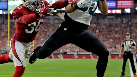 Arizona Cardinals safety Budda Baker (36) breaks up a pass intended for Jacksonville Jaguars tight end James O'Shaughnessy (80) during the second half of an NFL football game, Sunday, Nov. 26, 2017, in Glendale, Ariz. (AP Photo/Rick Scuteri)