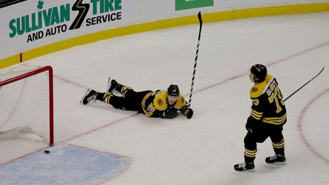 Boston Bruins right wing David Pastrnak (88) and defenseman Charlie McAvoy (73) react after an empty net goal by the Edmonton Oilers during the third period of an NHL hockey game in Boston, Sunday, Nov. 26, 2017. (AP Photo/Mary Schwalm)