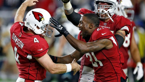 Arizona Cardinals kicker Phil Dawson (4) celebrates his game winning 57-yard field goal during the second half of an NFL football game against the Jacksonville Jaguars with cornerback Patrick Peterson (21), Sunday, Nov. 26, 2017, in Glendale, Ariz. The Cardinals won 27-24. (AP Photo/Ross D. Franklin)