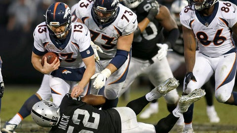 Oakland Raiders defensive end Khalil Mack (52) sacks Denver Broncos quarterback Trevor Siemian (13) during the second half of an NFL football game in Oakland, Calif., Sunday, Nov. 26, 2017. The Raiders won 21-14. (AP Photo/D. Ross Cameron)