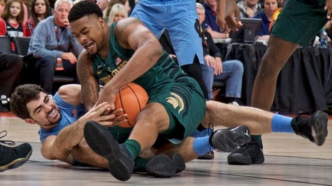 Michigan State forward Nick Ward, right, and North Carolina forward Luke Maye scramble for a loose ball during the first half of an NCAA college basketball game in the Phil Knight Invitational tournament in Portland, Ore., Sunday, Nov. 26, 2017. (AP Photo/Craig Mitchelldyer)