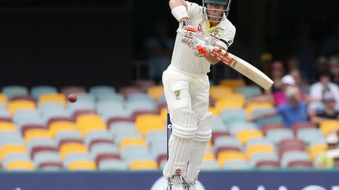 Australia's David warner plays a shot against England during their Ashes cricket test in Brisbane, Australia, Monday, Nov. 27, 2017. (AP Photo/Tertius Pickard)