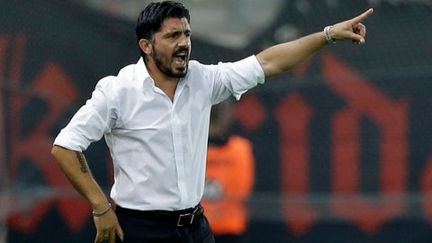 FILE - In this Sept. 13, 2014 file phtoto, OFI's coach Gennaro Gattuso of Italy gives instructions to his players during a Greek Soccer League match at the Georgios Karaiskakis stadium against Olympiacos in the port of Piraeus, near Athens. On Monday, Nov. 27, 2017 AC Milan fired Vincenzo Montella and named Gennaro Gattuso as coach Monday after the club failed to produce inspiring results with a completely revamped squad.  (AP Photo/Thanassis Stavrakis file)