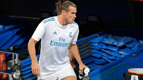 FILE - In this Aug. 23, 2017 file photo, Real Madrid's Gareth Bale steps from the tunnel onto the pitch at the Santiago Bernabeu stadium in Madrid, Spain. Bale is expected to make his return to Real Madrid's lineup in a Copa del Rey match against Fuenlabrada on Tuesday Nov. 28, 2017 after being sidelined for more than two months because of injuries. (AP Photo/Paul White, File)