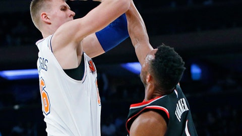 Portland Trail Blazers guard Evan Turner (1) defends New York Knicks forward Kristaps Porzingis (6) during the first half of an NBA basketball game in New York, Monday, Nov. 27, 2017. (AP Photo/Kathy Willens)