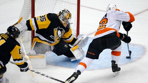 Philadelphia Flyers' Michael Raffl (12) backhands a shot behind Pittsburgh Penguins goalie Tristan Jarry (35) for a goal in the third period of an NHL hockey game in Pittsburgh, Monday, Nov. 27, 2017. The Penguins won in overtime 5-4. (AP Photo/Gene J. Puskar)