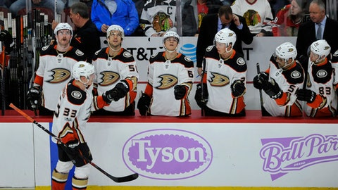 Anaheim Ducks' Jakob Silfverberg (33) of Sweden, celebrates with teammates on the bench after scoring a goal during the second period of an NHL hockey game against the Chicago Blackhawks Monday, Nov. 27, 2017, in Chicago. (AP Photo/Paul Beaty)