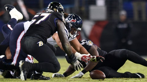 Baltimore Ravens inside linebacker C.J. Mosley (57) and Houston Texans offensive guard Xavier Su'a-Filo chase after a Texans fumble in the second half of an NFL football game, Monday, Nov. 27, 2017, in Baltimore. Baltimore recovered the ball on the play. (AP Photo/Gail Burton)