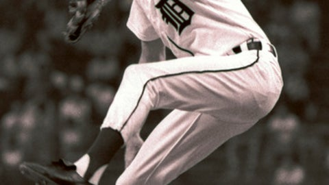 FILE - In this June 16, 1977, file photo, Detroit Tigers' Mark Fidrych pitches to the Toronto Blue Jays during a baseball game in Detroit. A Massachusetts appeals court has dismissed a wrongful-death lawsuit filed by the widow of former Major League pitcher Mark Fidrych. Court records show the 54-year-old died of asphyxiation in 2009 after his clothing became tangled in a spinning piece of a dump truck he was working on. Ann Pantazis filed a lawsuit in 2012 against the makers of the truck and the spinning component, arguing they did not provide sufficient warnings. The court ruled unanimously Monday, Nov. 27, 2017, the companies did provide warnings and the equipment had no design defects. (AP Photo/File)