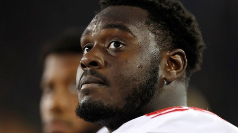 FILE - This Nov. 4, 2017, file photo shows Ohio State offensive lineman Isaiah Prince watching from the sideline during the second half of an NCAA college football game against Iowa in Iowa City, Iowa. No. 8 Ohio State's improved offensive line will have a big challenge slowing down No. 3 Wisconsin's powerful defensive front. The Buckeyes' line has stabilized after an inconsistent season in 2016. They'll face a Badgers front that anchors the best defense in the nation.  (AP Photo/Charlie Neibergall, File)