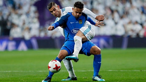 Real Madrid's Theo Hernandez, rear, vies for the ball with Fuenlabrada's Hugo Fraile during a Spanish Copa del Rey round of 32 second leg soccer match between Real Madrid and Fuenlabrada at the Santiago Bernabeu stadium in Madrid, Tuesday, Nov. 28, 2017. (AP Photo/Francisco Seco)