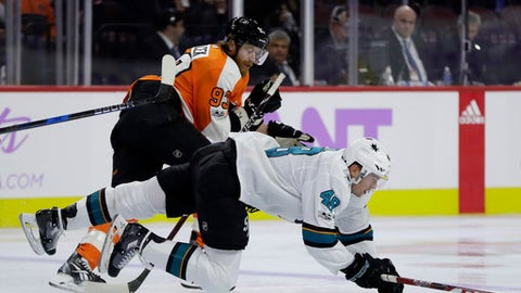 San Jose Sharks' Tomas Hertl (48) gets tripped by Philadelphia Flyers' Jakub Voracek (93) during the second period of an NHL hockey game, Tuesday, Nov. 28, 2017, in Philadelphia. (AP Photo/Matt Slocum)
