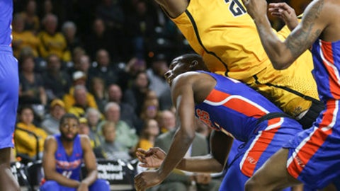 Wichita State forward Darral Willis Jr. is fouled by Savannah State guard Isaiah Felder during the first half of an NCAA college basketball game, Tuesday, Nov., 28, 2017 in Wichita, Kan. (Travis Heying/The Wichita Eagle via AP)