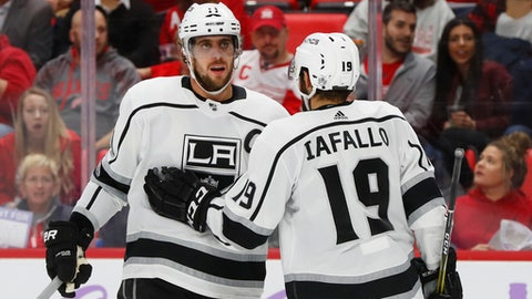 Los Angeles Kings center Anze Kopitar (11) celebrates his goal against the Detroit Red Wings with Alex Iafallo (19) in the third period of an NHL hockey game Tuesday, Nov. 28, 2017, in Detroit. (AP Photo/Paul Sancya)