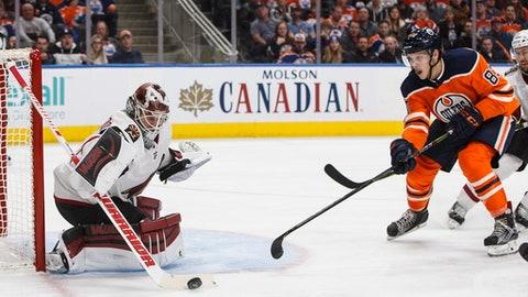 Phoenix Coyotes goalie Scott Wedgewood (31) makes the save on Edmonton Oilers' Matthew Benning (83) during the second period of an NHL hockey game in Edmonton, Alberta, Tuesday, Nov. 28, 2017. (Jason Franson/The Canadian Press via AP)