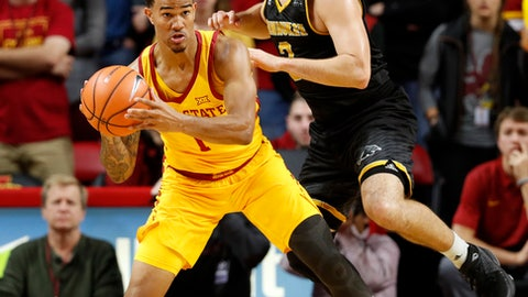 FILE - In this Nov. 13, 2017, file photo, Iowa State guard Nick Weiler-Babb drives around Milwaukee guard Brock Stull, right, during the second half of an NCAA college basketball game, in Ames, Iowa. Iowa State is finally getting the best out of Nick Weiler-Babb _ by turning him into a ball handler.  (AP Photo/Charlie Neibergall, File)