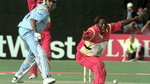FILE - This is a Wednesday May 19, 1999 file photo of Zimbabwe's Henry Olonga, right, appeals for LBW against India's Venkatesh Prasat, center, to give victory to his team over India at the Grace Road ground in Leicester, England. When two Zimbabwe cricketers staged a daring protest against the regime of Robert Mugabe at a World Cup game 14 years ago, they knew it would seriously compromise their careers and maybe even put their lives in danger. But Henry Olonga, a cricketer by day and a singer by night, couldn't have known that a patriotic song he first recorded in a small bedroom would become the soundtrack of change in Zimbabwe when Mugabe was finally forced out of power over a decade later.  (AP Photo/Max Nash/File)