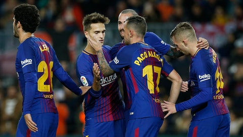 FC Barcelona's Paco Alcacer, 17, center, is congratulated by teammates after scored during a Spanish Copa del Rey round of 32 second leg soccer match between FC Barcelona and Murcia at the Camp Nou stadium in Barcelona, Wednesday, Nov 29, 2017. (AP Photo/Manu Fernandez)